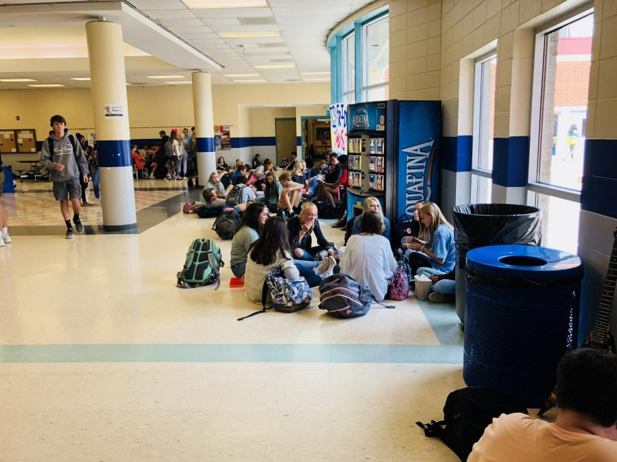 Various students congregate in the halls to enjoy their lunch with friends.