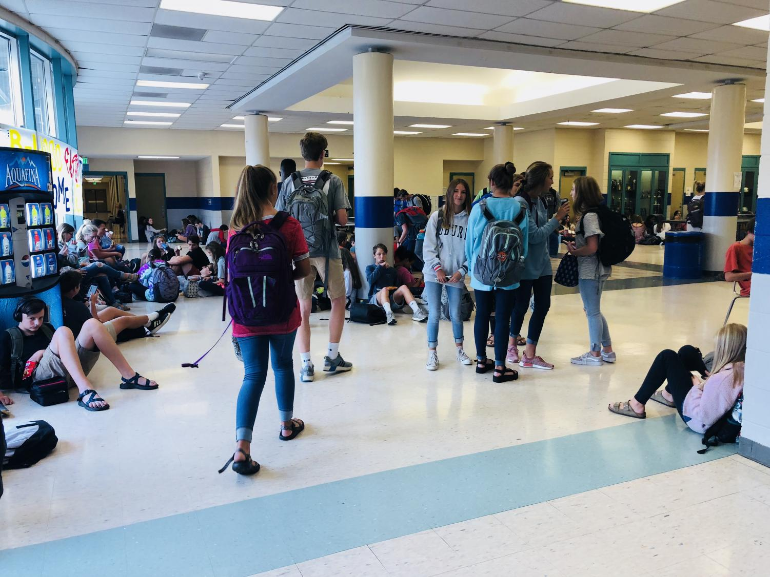 Students walk around the lobby in search of their friends and a place to sit.