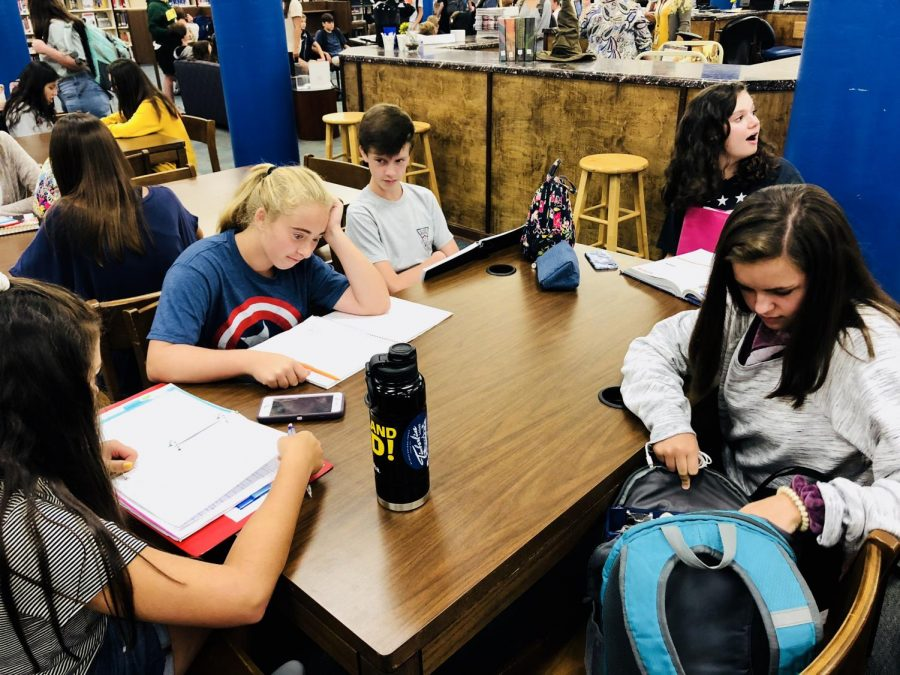 Students, Madelyn Riggins, Reed Parish, Phoebe Black, Vella Barnes, and Madison Taylor use their allotted halftime time to study for their tests in the library.
